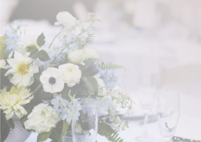 A vase of flowers on a table - Wedding